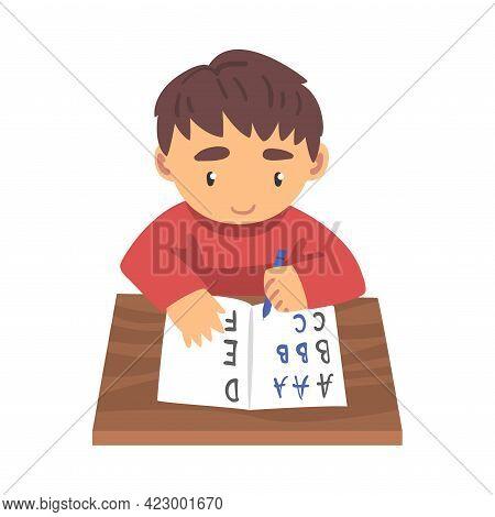 Cute Boy Learning To Write, Elementary School Student In Casual Uniform Making Homework Cartoon Vect