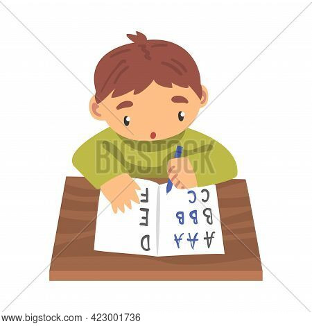 Cute Boy Learning To Write, Elementary School Student Sitting At His Desk And Writing Cartoon Vector