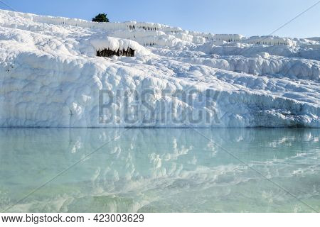 Snow White Travertine Terraces & Water Pool, Pamukkale, Turkey. Formations Created By Constantly Flo