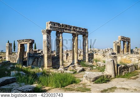 Ruins Of Ancient Colonnade & Ancient Buildings On Frontinus Street In  Antique City Hierapolis, Pamu
