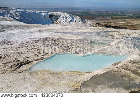 Far Part Of Pamukkale's Travertine Park, Turkey. Some Of Terraces Are Empty (it's Needed For Their F