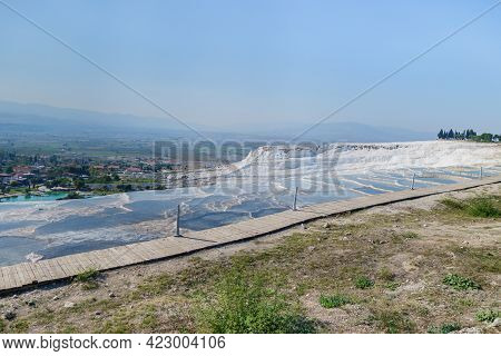 Side View On Travertine Terraces Of Pamukkale, Turkey. There Are Tourist Pathway Made Of Ecological