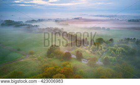 Summer Cloudy Rainy Foggy Morning Panorama. Rural Misty River, Fields, Meadow, Village. Spring Overc