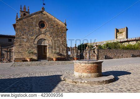 Church Of Santa Maria Assunta On Rome Square In Monteriggioni, Italy