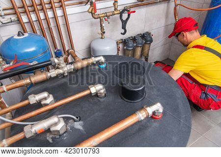 Home Water Heating And Distribution System With On Fly Filters Installing By Professional Hvac Worke
