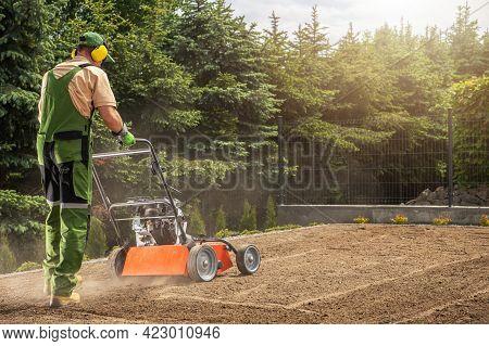 Professional Caucasian Gardener In His 40s Aerating Backyard Lawn Using Powerful Gasoline Pro Equipm