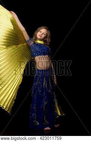 Beautiful Blonde Girl Dancing Belly Dance With Wings, Charming Child With Long Hair Wearing Traditio