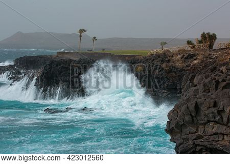 View Of The Atlantic Ocean And The Golf Course. Amazing Landscape Of Deep Blue Ocean And Volcanic Ro