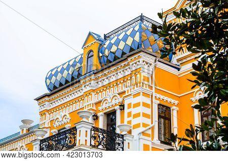 Sochi, Russia - October 26, 2019: Riviera Park. Khludov's Dacha. Yellow Facade. Shiny Roof. Grey Sky