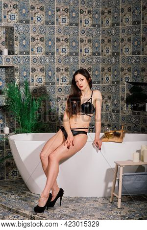 Shapely Seductive Woman In White And Black Lingerie Standing In Cloakroom, Near Wardrobe, Bathroom