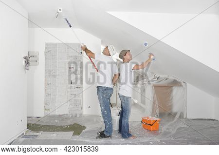 Couple Painting Renovating Apartment Renovation With White Wall Color