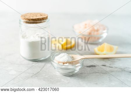 Eco Friendly Natural Cleaners, Jar With Baking Soda, Lemon, Pink Salt And Wooden Spoon On Marble Tab