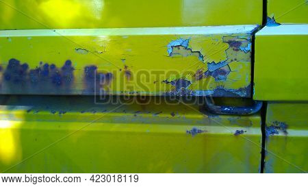 Sheet Metal Corrosion Of Old Yellow Car Body. Rusty Steel Surface, Background And Damaged Texture. P