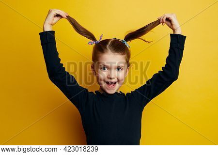 Young Funny Cute Little Kid Girl Playing With Her Hair, Ponytails