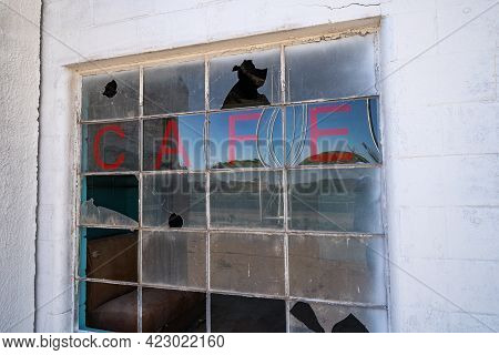 Old Abandoned Cafe Sign On A Broken, Busted Window, In The Glenrio, Texas Ghost Town Along Route 66