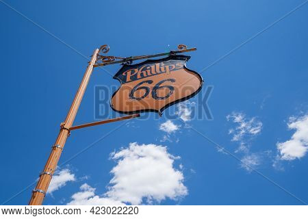 Mclean, Texas - May 6, 2021: Old Fashioned Phillips 66 Gas Station Sign Against A Bright Blue Sky Al