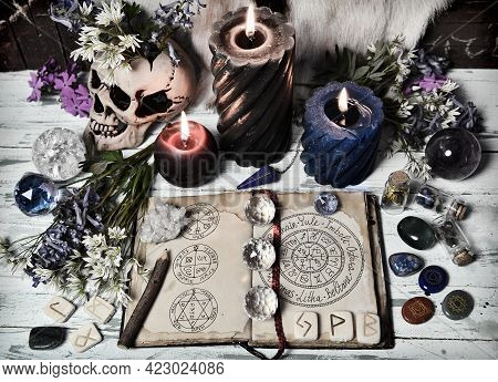 Grunge Still Life With Open Witch Book, Crystal, Flowers, Burning Candles On Altar Table. Esoteric,