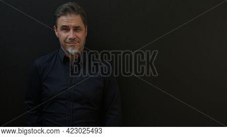 Confident businessman smiling. Portrait of mature age, middle age, mid adult man in 50s, happy confident smile. Copyspace.