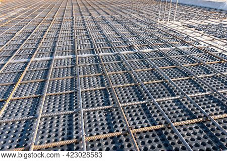 Close Up View Of Reinforcement Of Concrete. Geometric Alignment Of Rebars On Construction Site. Rein