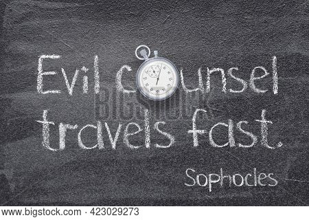 Evil Counsel Travels Fast - Quote Of Ancient Greek Philosopher Sophocles Written On Chalkboard With