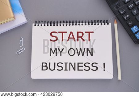 Start My Own Business Text Written In Notebook, Business Concept, Gray Background, Pencil, Notebook