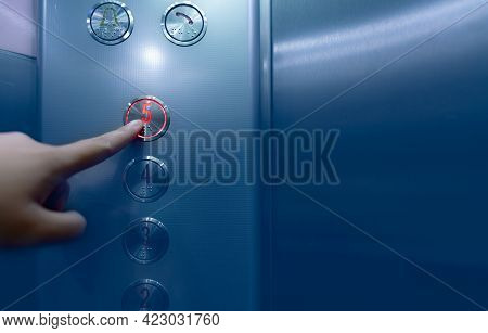 Person Pressing On The Fifth Floor Of Elevator Button. Hand Press Number 5 On Button Inside Office O