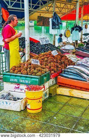 Valdivia, Chile - October 16, 2005: Sea Food Market Scene With Sellers, In Valdivia, Central Chile