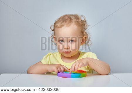 Popular Anti Stress Toy Pop It. Child Playing With The Pop It Fidget Toy. Happy Childhood, Popular E