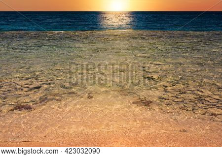 Beautiful Sunrise On Beach Ocean Scene With Blue Wave On Seashore With Reflection Of Sun Rays On The