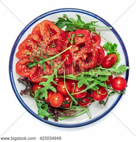 Ripe Fresh Tomatoes Salad With Herbs, Spices On A Plate  Isolated On White Background. Summer Salad