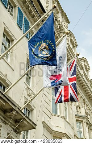 London, Uk - April 21, 2021: Flags Outside The Royal College Of Nursing Headquarters Which Represent