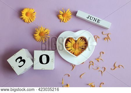 Calendar For June 30: The Name Of The Month Of June In English, Cubes With The Number 30, A Cup Of T
