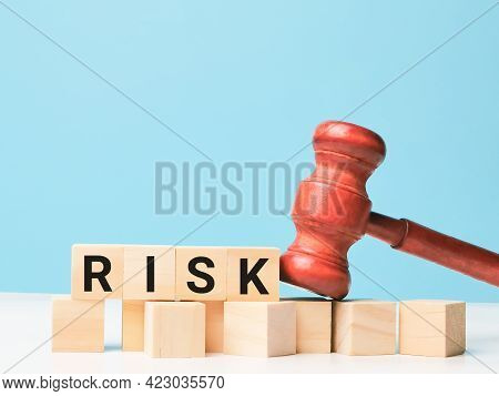 Financial Risk Assessment, Risk Reward And Portfolio Risk Management Concept. Phrase Risk On Wooden