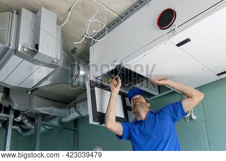Hvac Technician Install Ducted Heat Recovery Ventilation System With Recuperation