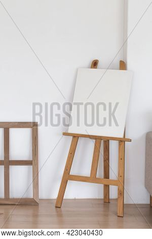 Wooden Empty Easel In The Room Interior