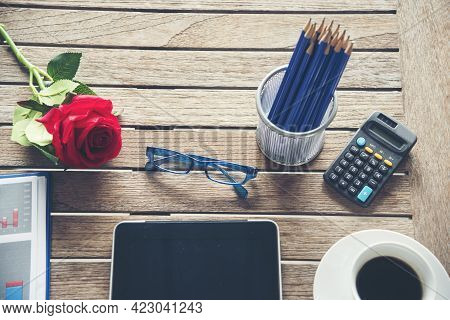 Top View Office Desk Laptop And Coffee Cup On Wood Table Copy Space. Tabletop Notebook Laptop Coffee
