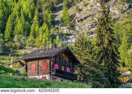 Evolene, Switzerland - June 1, 2021:traditional Wooden House In Evolene, A Village In The Valley Of