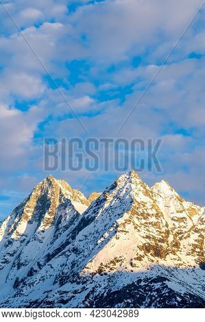 Snow Covered Mountain Peaks Of Dent De Veisivi And Denti De Perroc Above Val Herens In Switzerland A