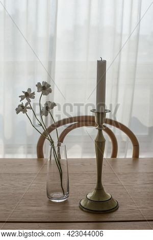 Glass Vase With Candlestick On Wooden Table.