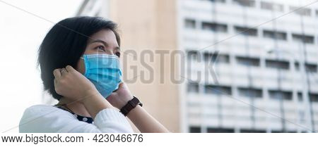 Asian Female Wearing Protective Face Mask At Outdoor In The City While Covid-19 Or Coronavirus Pande