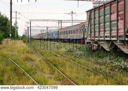 Transport - Old Freight And Passenger Railroad Cars Train With The Broken Windows.