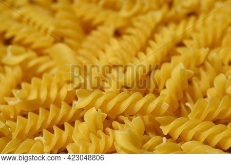 Close Up Of Dry Yellow Uncooked Fusilli