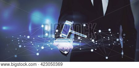 Online Auction Bidding Concept With A Man In A Black Suit Showing A Digital Hammer On The Palm Of Hi