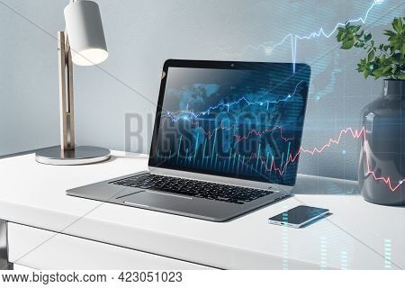 Stock Market Concept With Stylish Workspace, World Map And Financial Chart Indicators On Modern Lapt