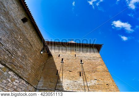 Fragment Of A Brick Fortress Wall With A Tower And Elevator Chains. Fortress Oreshek On A Sunny Summ
