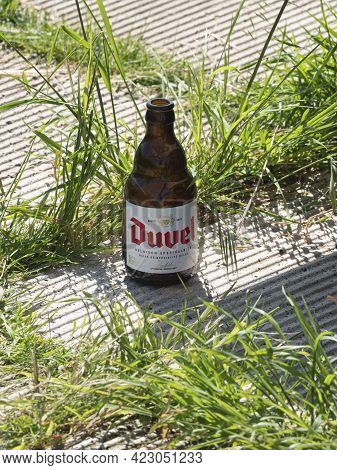 Basel, Belgium, May 30, 2021, Empty Bottle Of Belgian Beer Called Duvel Left On The Side Of A Road
