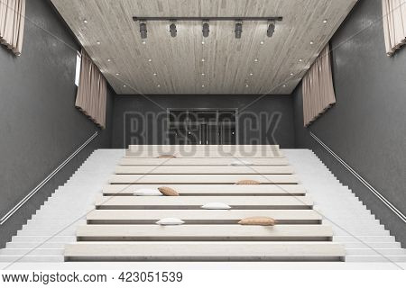 Modern Home Movie Theater With Comfortable Pillows On Stairs Seats, Wooden Details And Concrete Wall