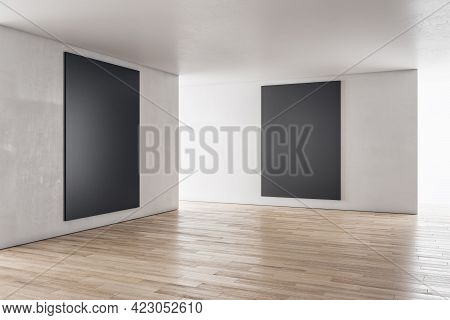 Modern Concrete Interior With Sunlight And Empty Black Frame Mockup Place. Exhibition, Art And Adver