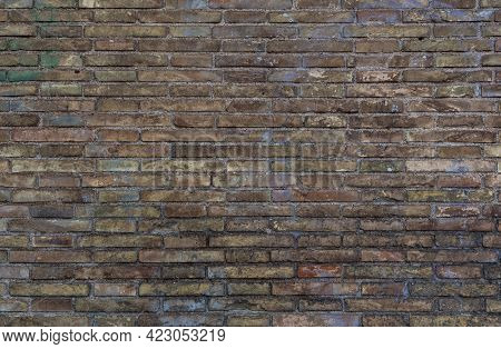 Brick Wall Background. Old Brickwork With Multicolor Bricks In Tints Of Brown, Yellow, Green, Blue W