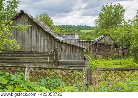 Part Of The Old Facade Of An Abandoned Village House